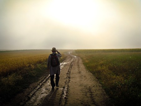man on a dusty road